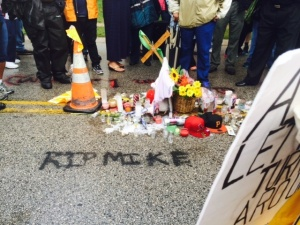 A makeshift memorial for another black boy felled by a policeman's gun.